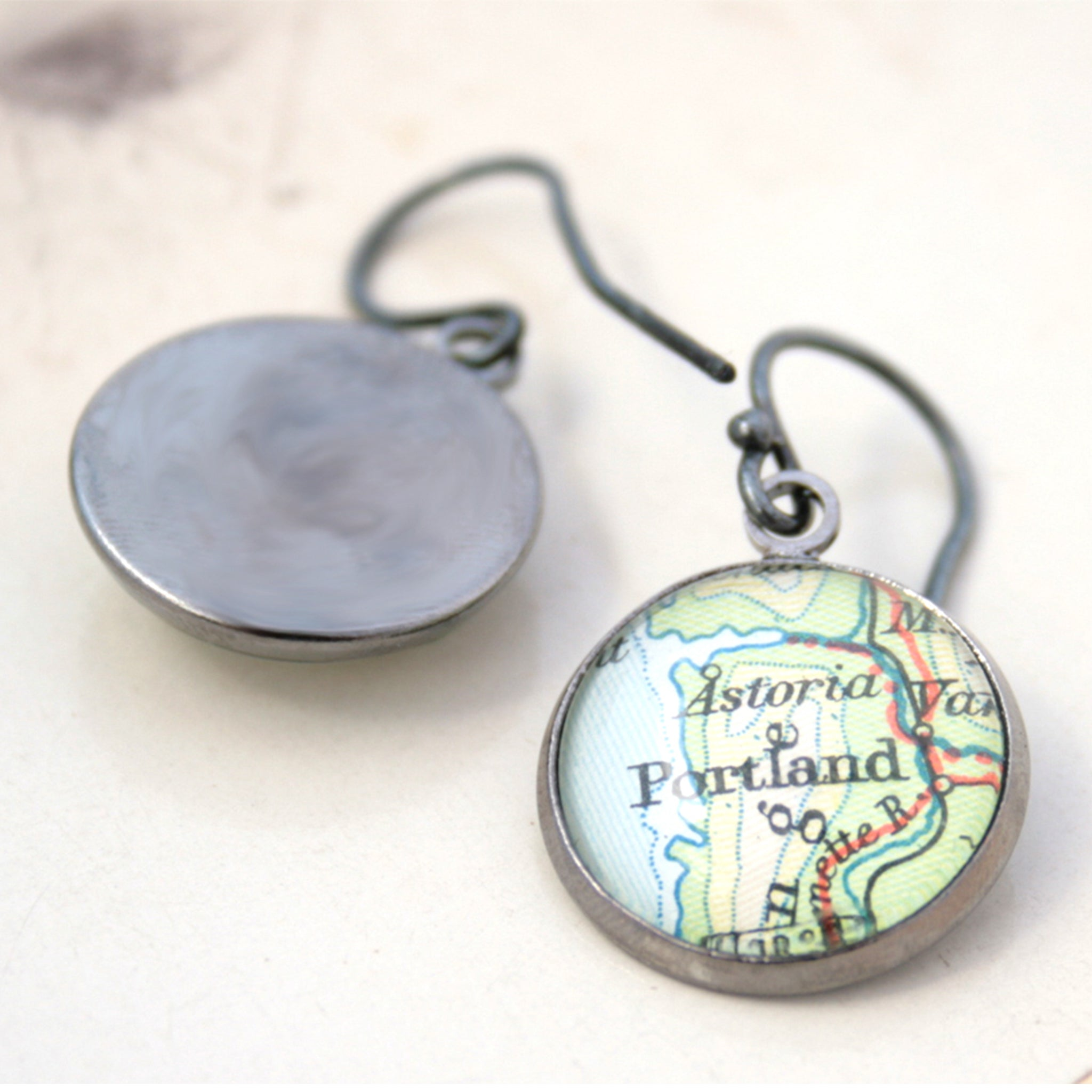 Gunmetal dangle earrings featuring maps of Bologna and Portland