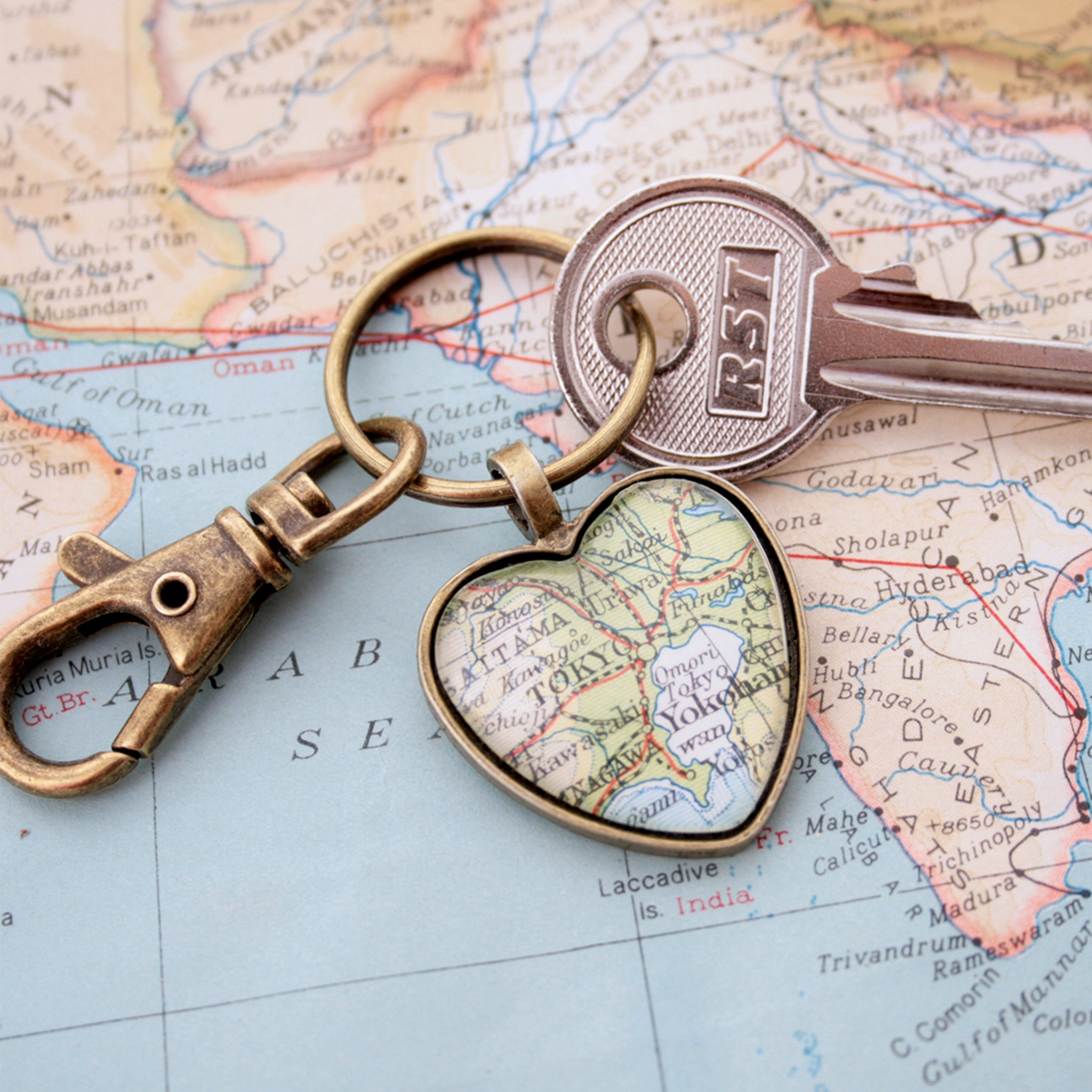 Heart shaped keychain in bronze tone featuring map of Tokyo