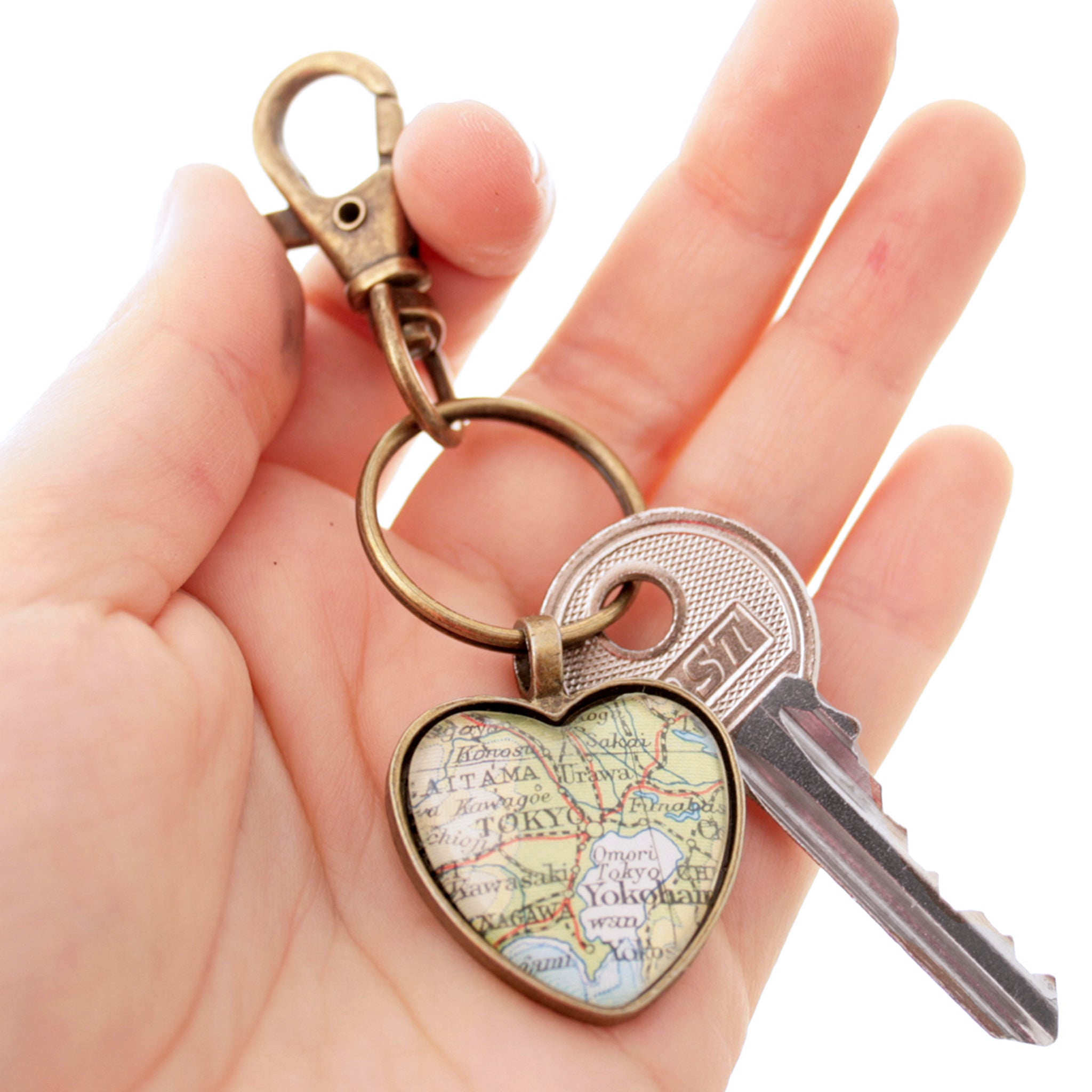 Hold in hand Heart shaped keychain in bronze tone featuring map of Tokyo