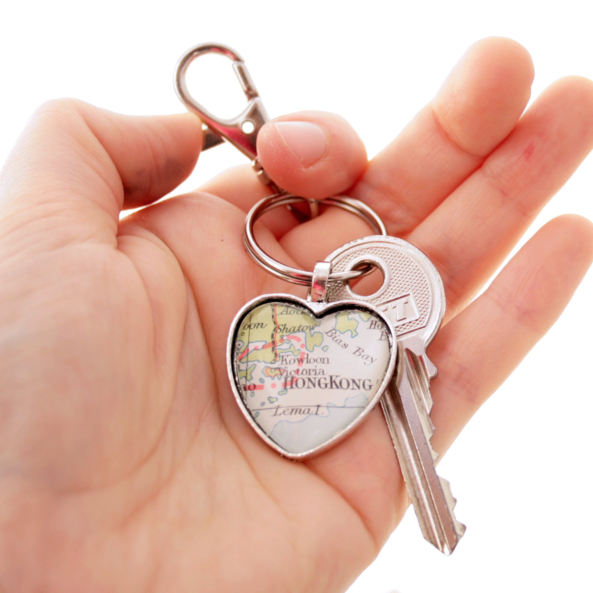 Hold in hand Heart shaped keychain in silver tone featuring map of Hong Kong