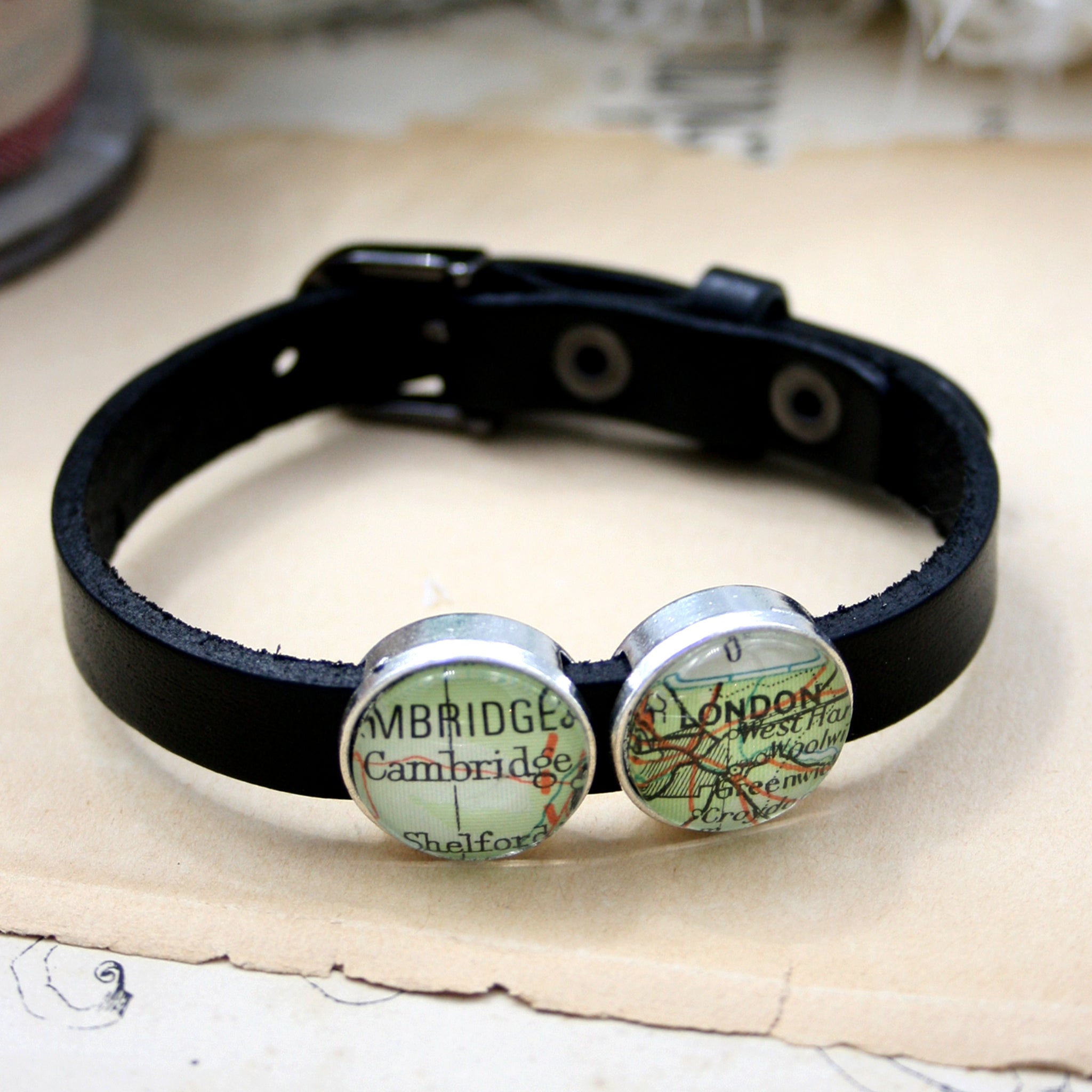 Black leather bracelet featuring map locations