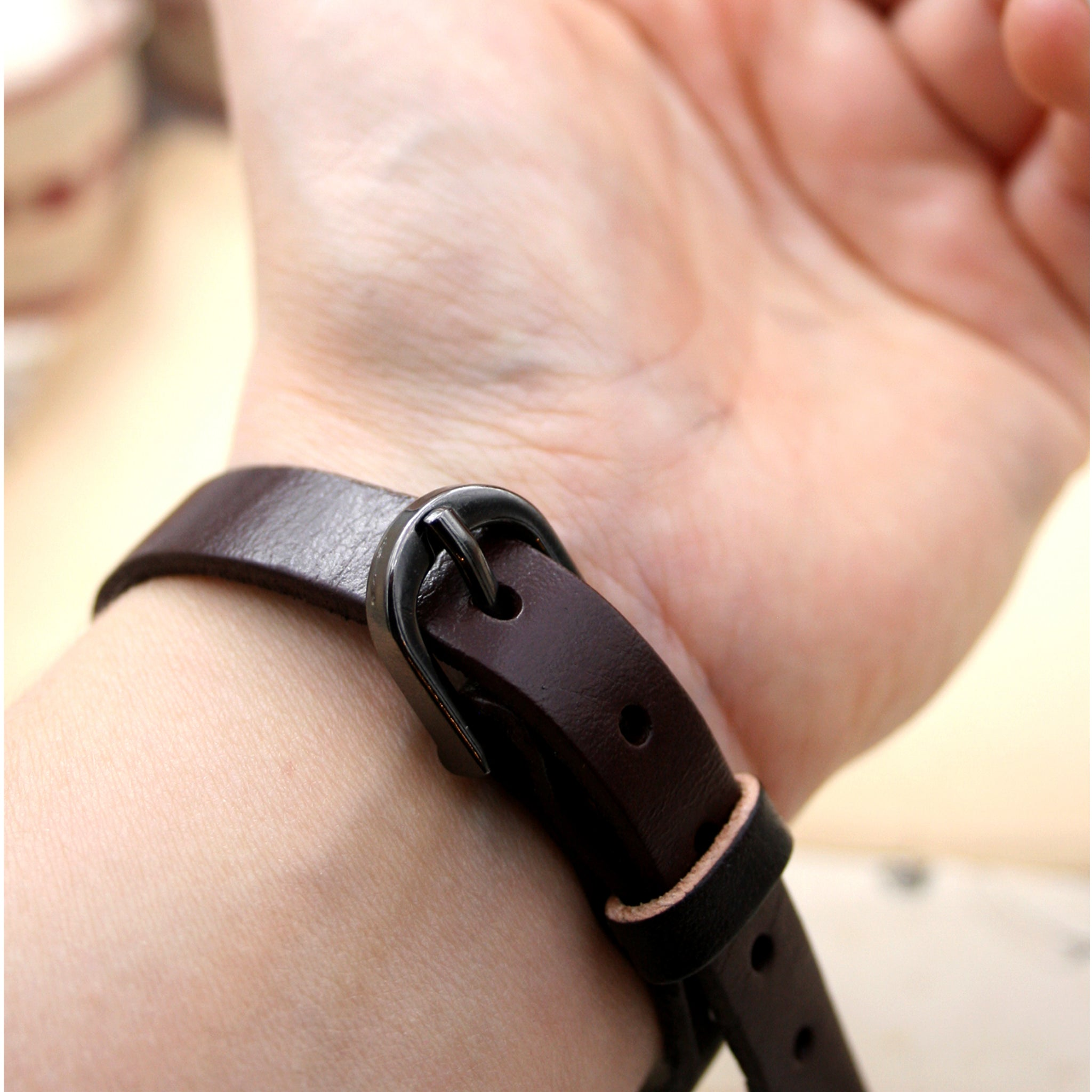 Worn on hand brown leather bracelet buckle