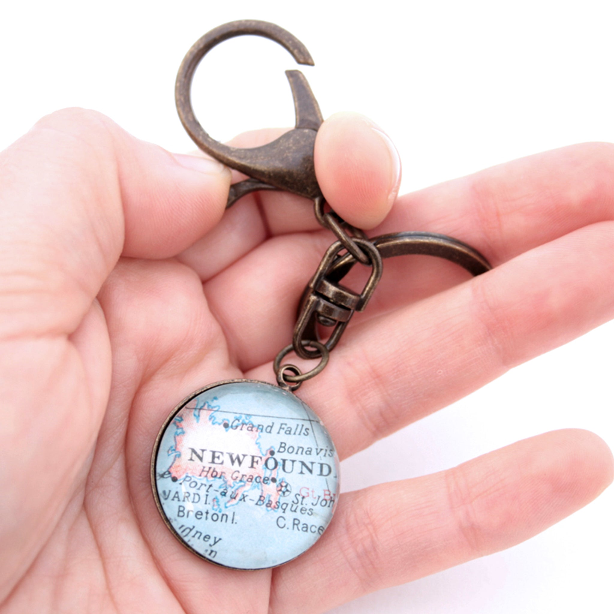 HOld in hand Personalised keyring in antique bronze color featuring map of Newfoundland