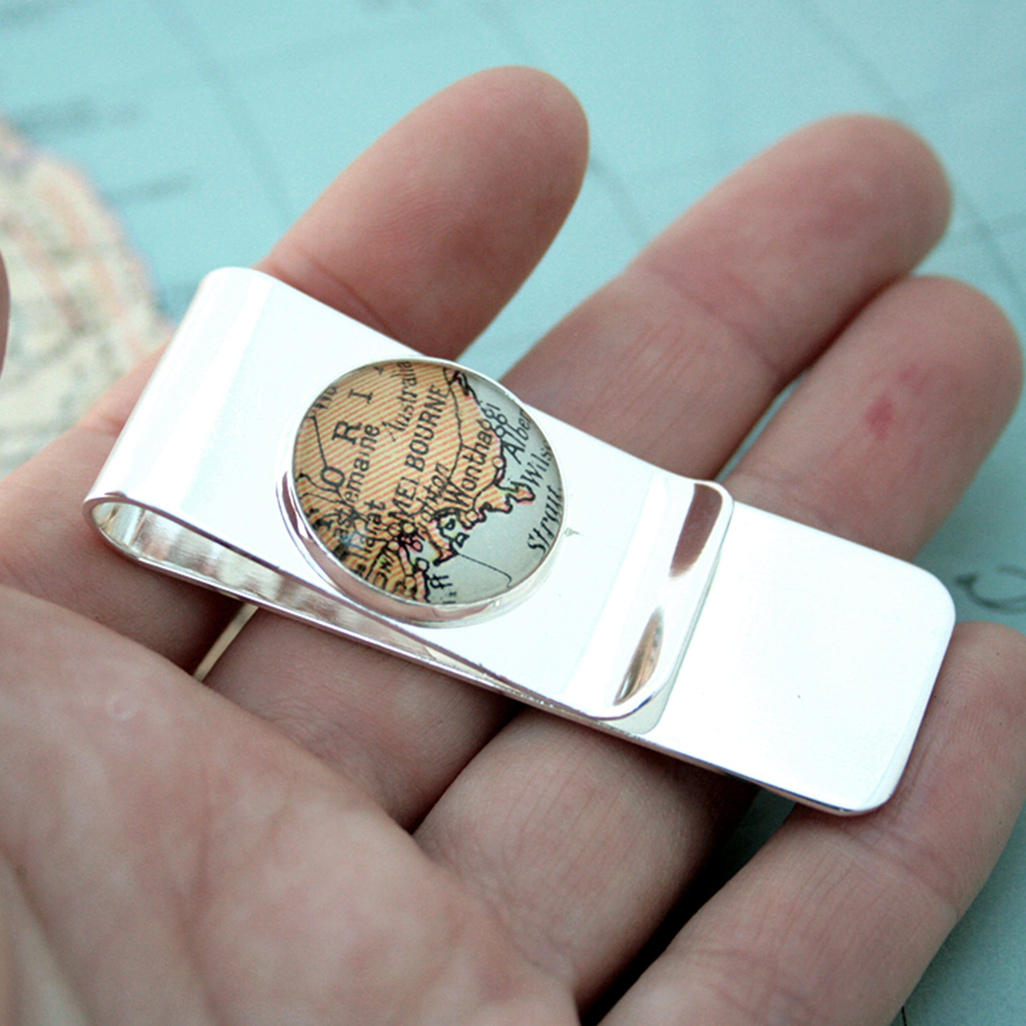 Hand holding Silver money clip featuring map of Melbourne
