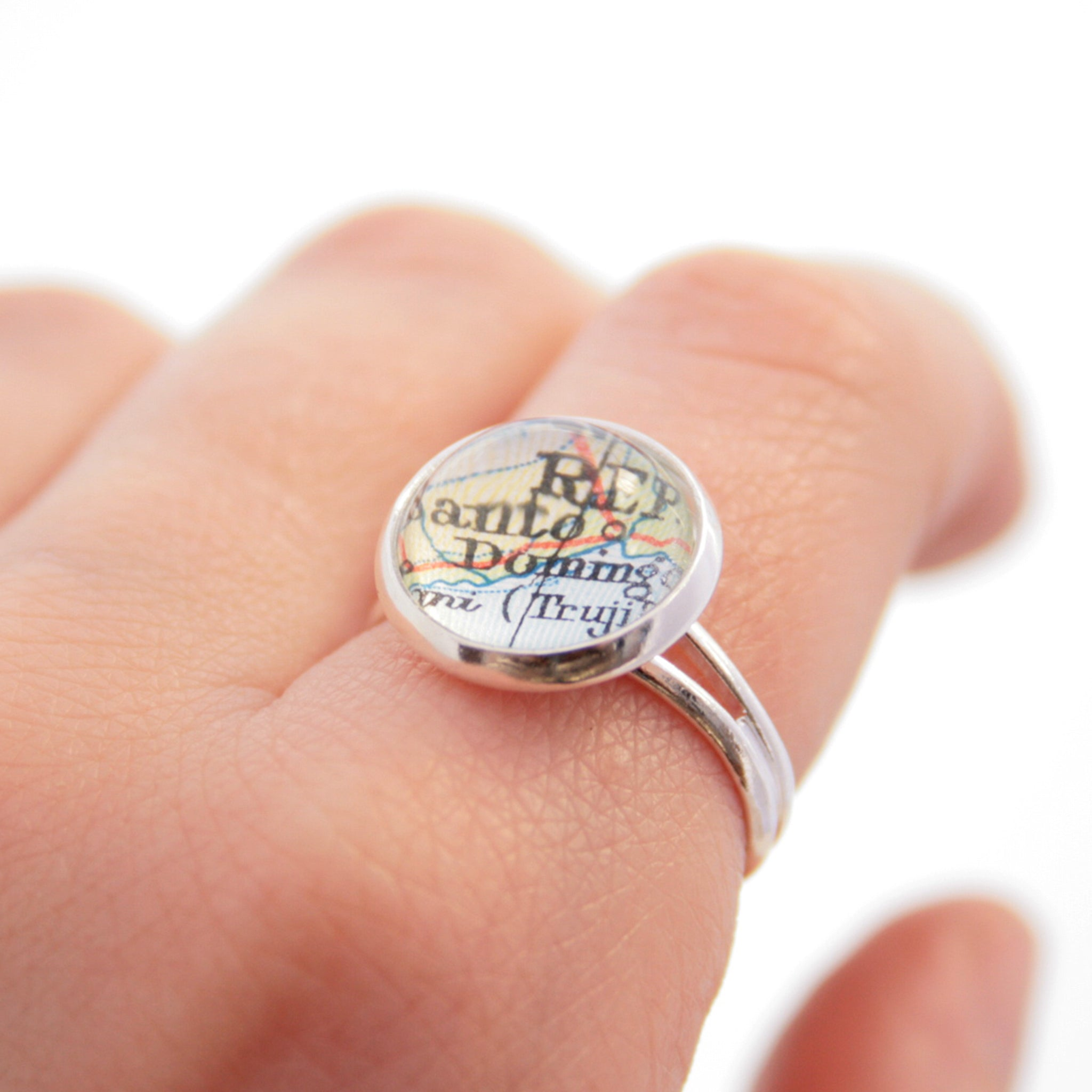 tiny wanderlust ring in silver tone personalised with map of Dominican Republic worn on hand