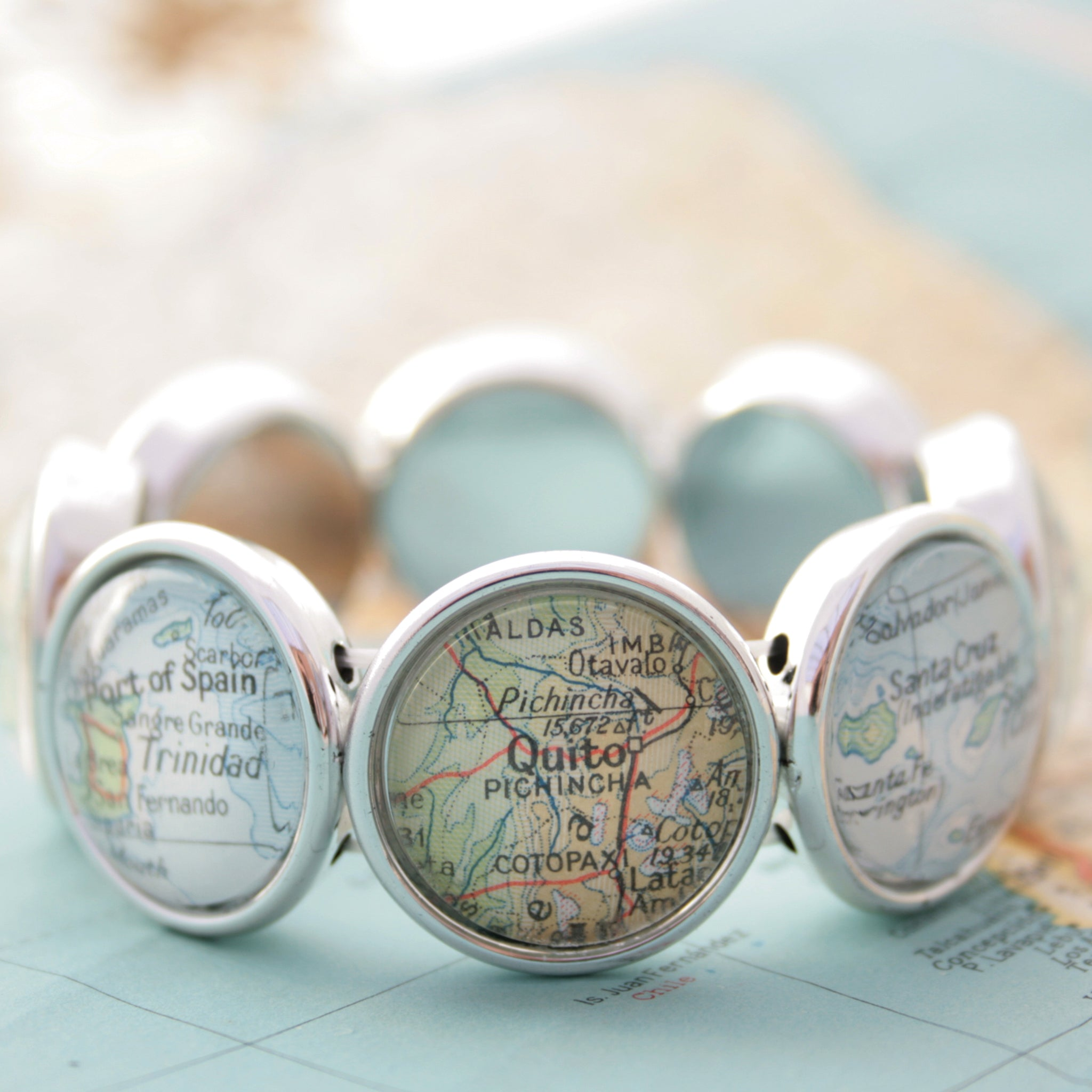 Stretchy bracelet in silver tone featuring custom map locations