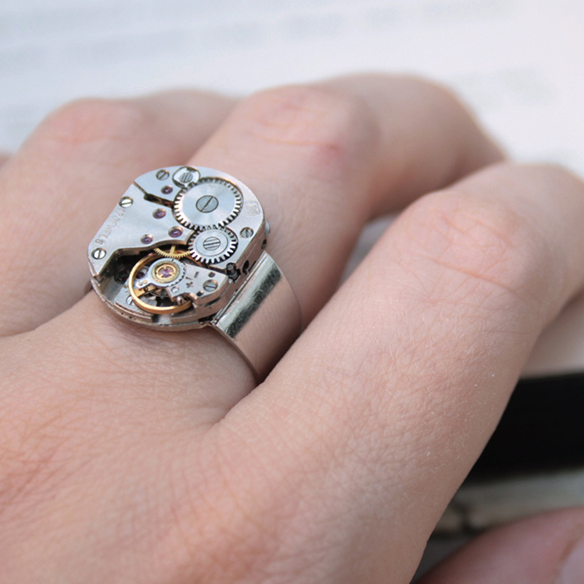 Mens Pinky Ring in Steampunk Style made of watch mechanism worn on hand