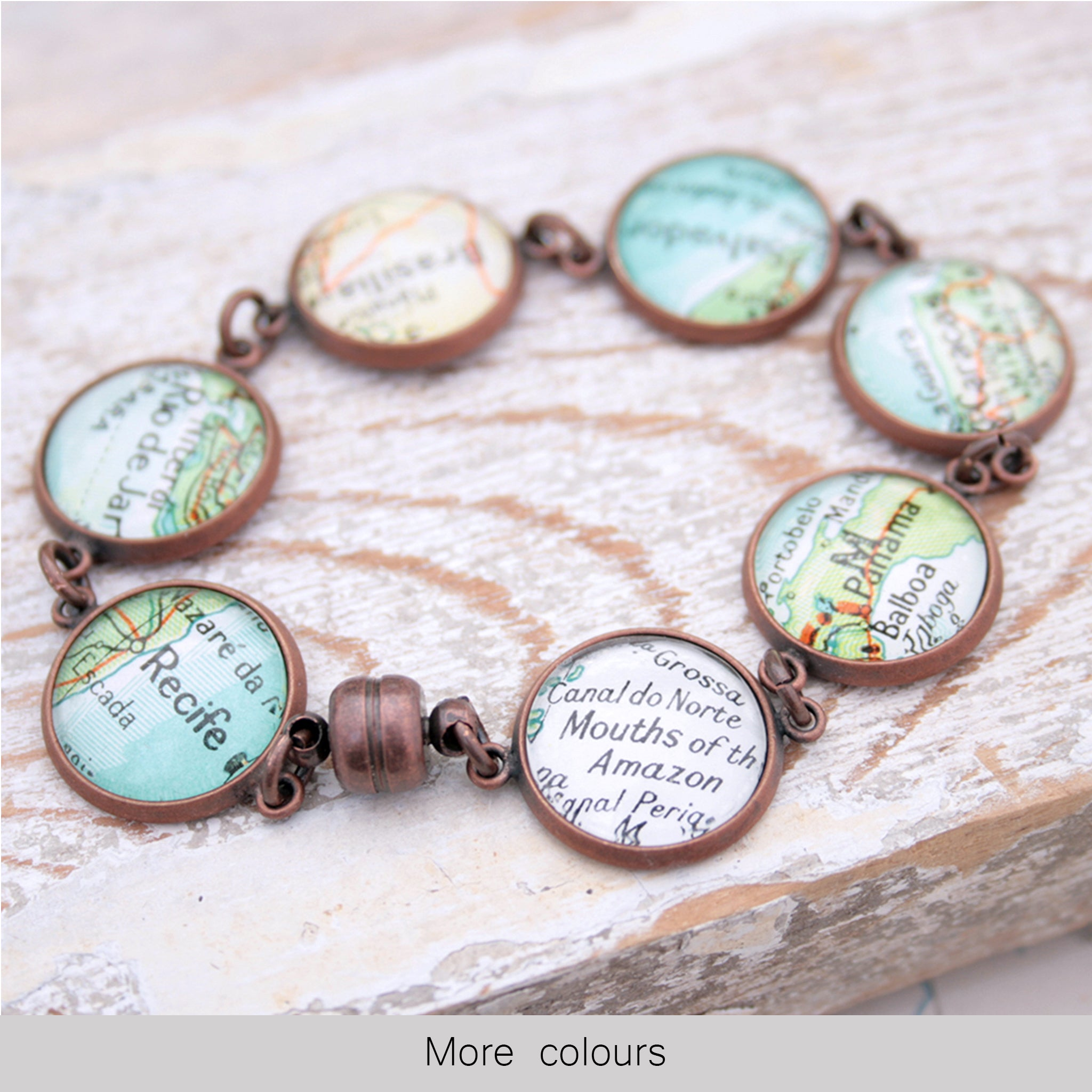 Antique copper beaded bracelet featuring different map locations