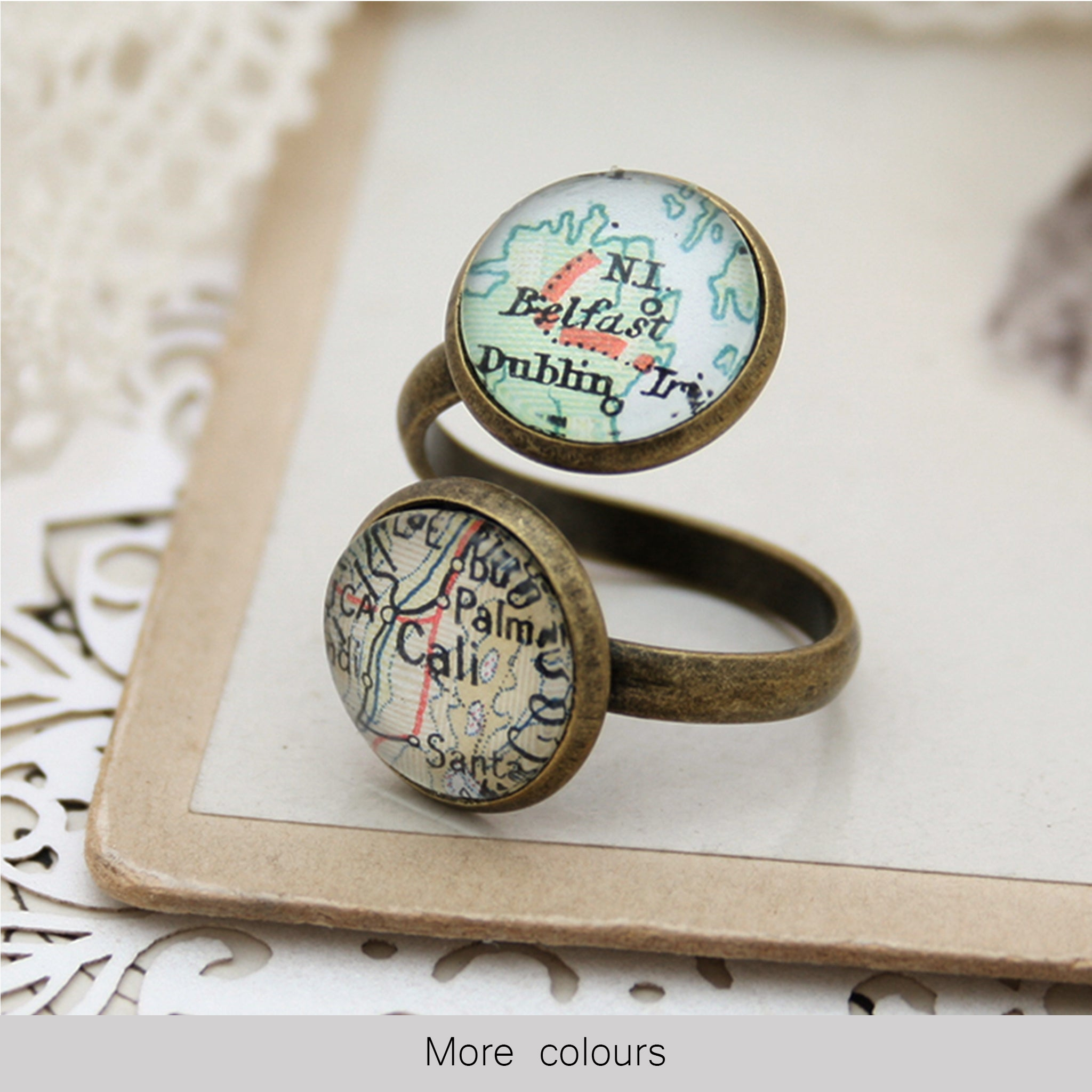 Thumb ring in antique bronze color featuring to custom map locations
