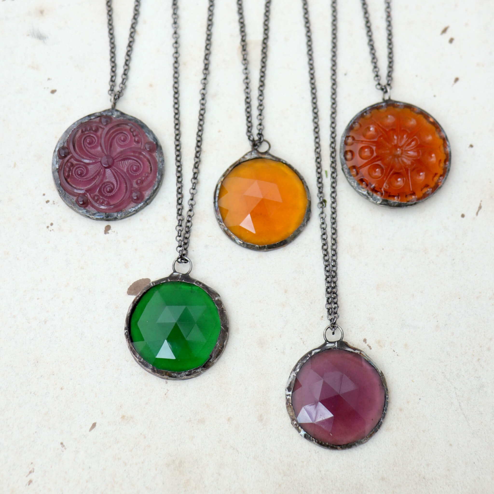 Amethyst, emerald and amber glass soldered into stained glass necklaces
