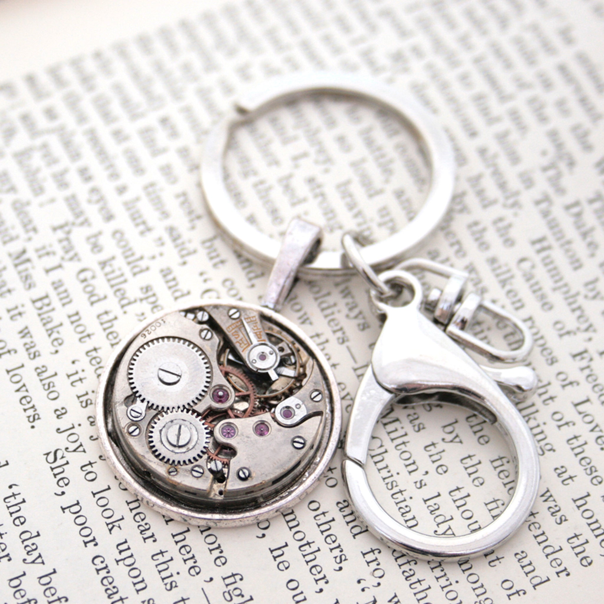 steampunk keyring for man, made of real antique watch movement on metal base in silver tone