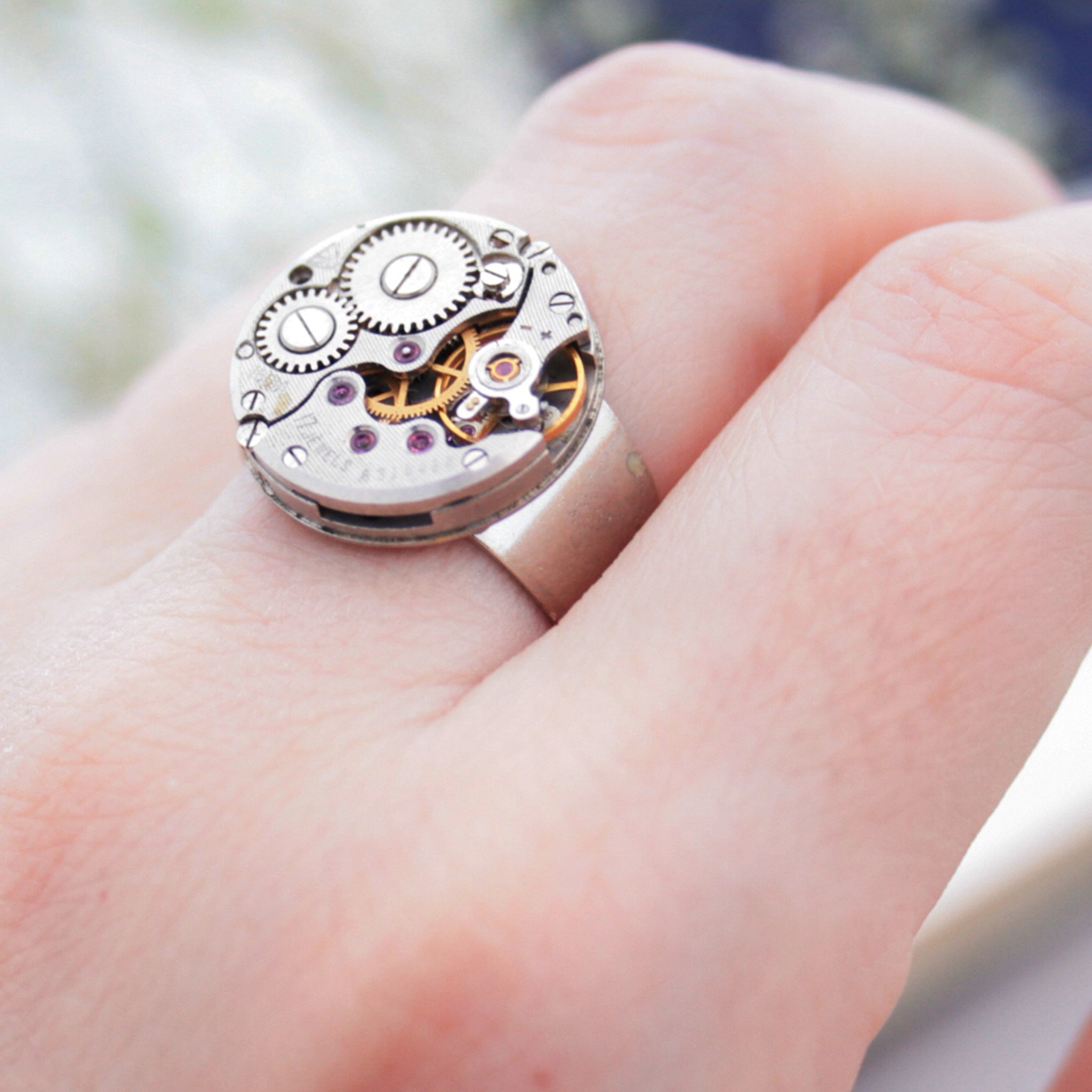 Round Steampunk Mens Signet Ring made of watch inside on hand