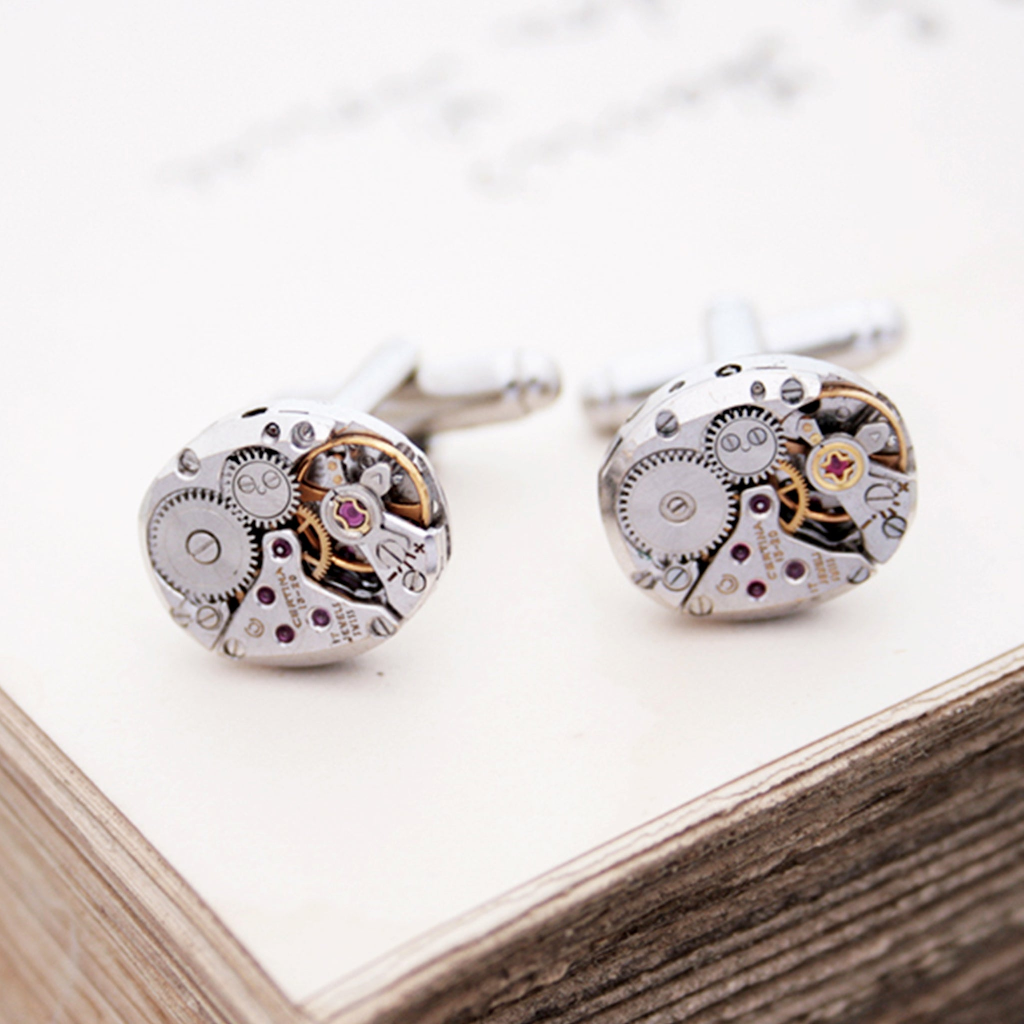 sterling cufflinks made of antique Certina watch movements