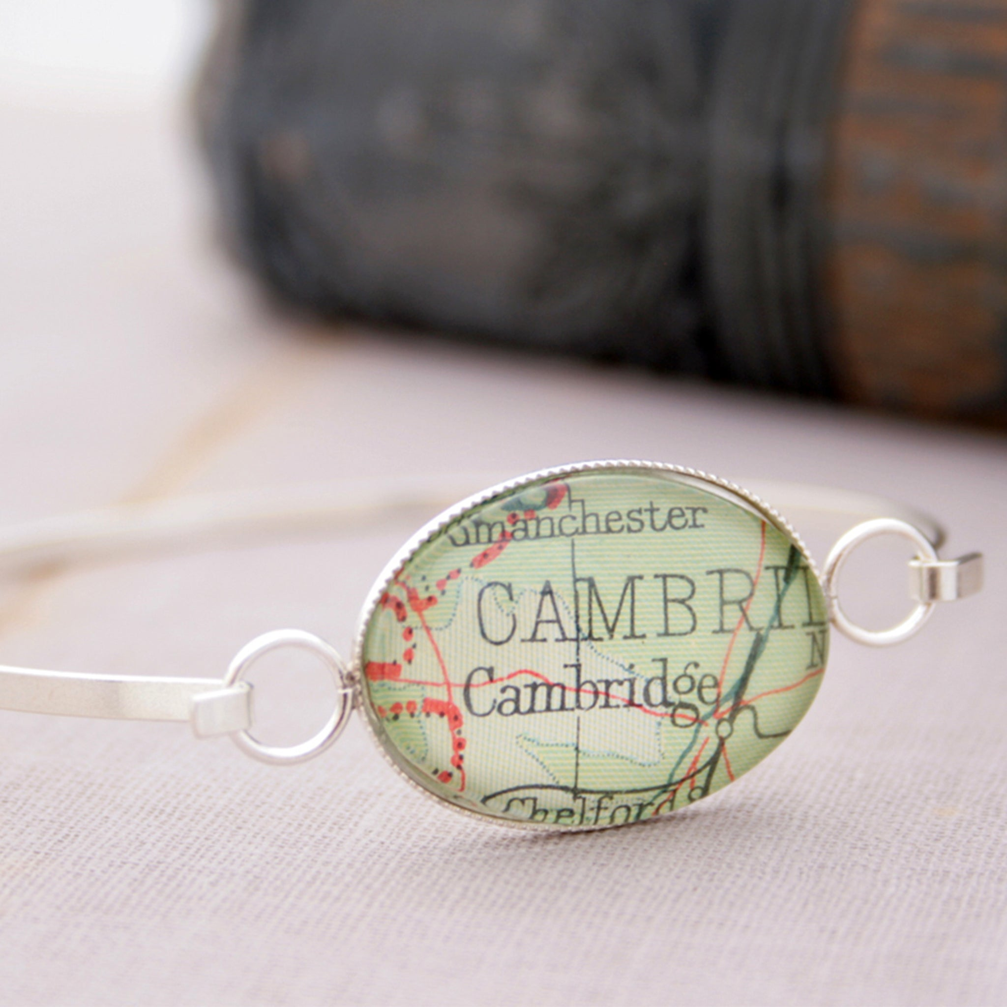 Sterling silver bangle bracelet featuring map of Cambridge