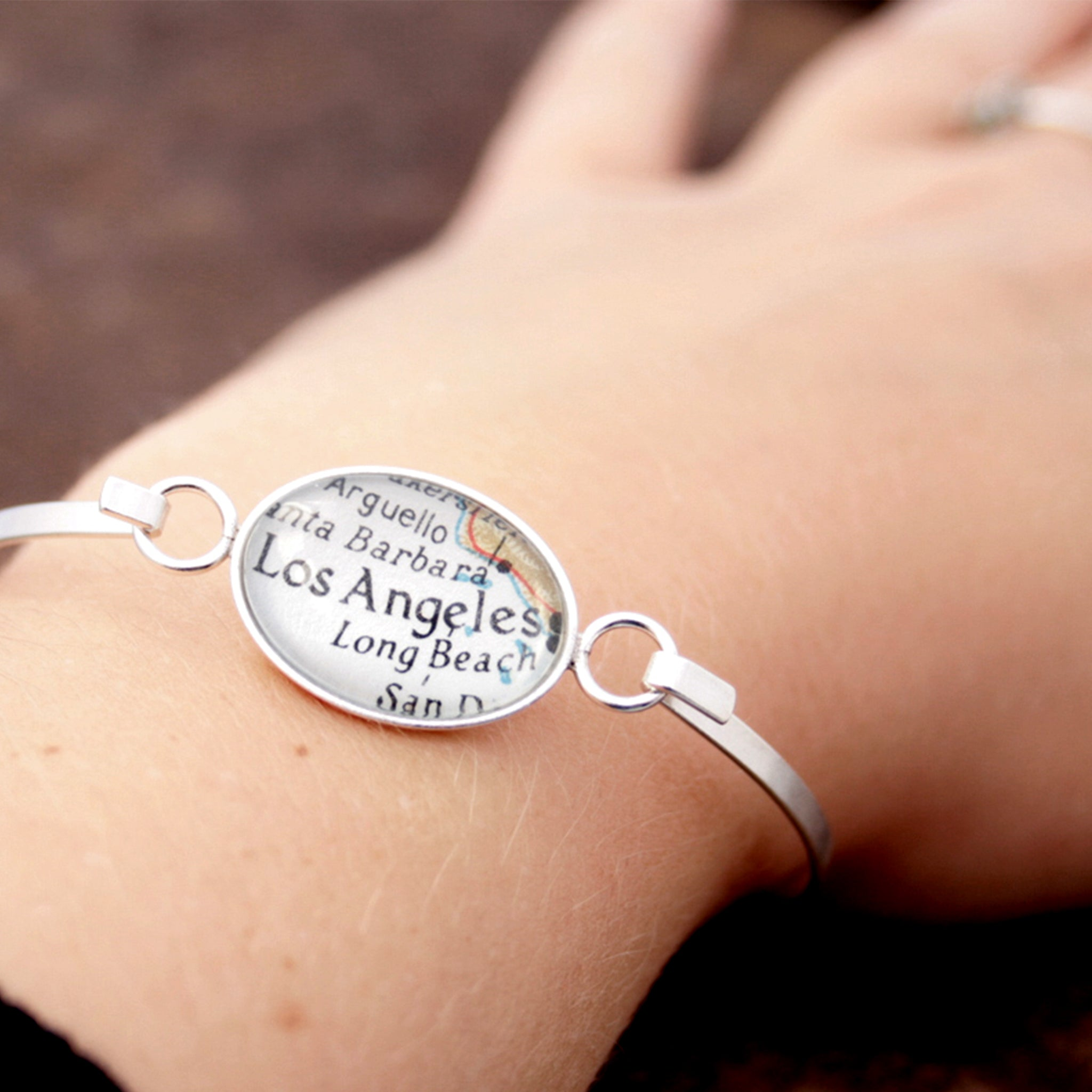 Worn on hand Sterling silver bangle bracelet featuring map of Los Angeles
