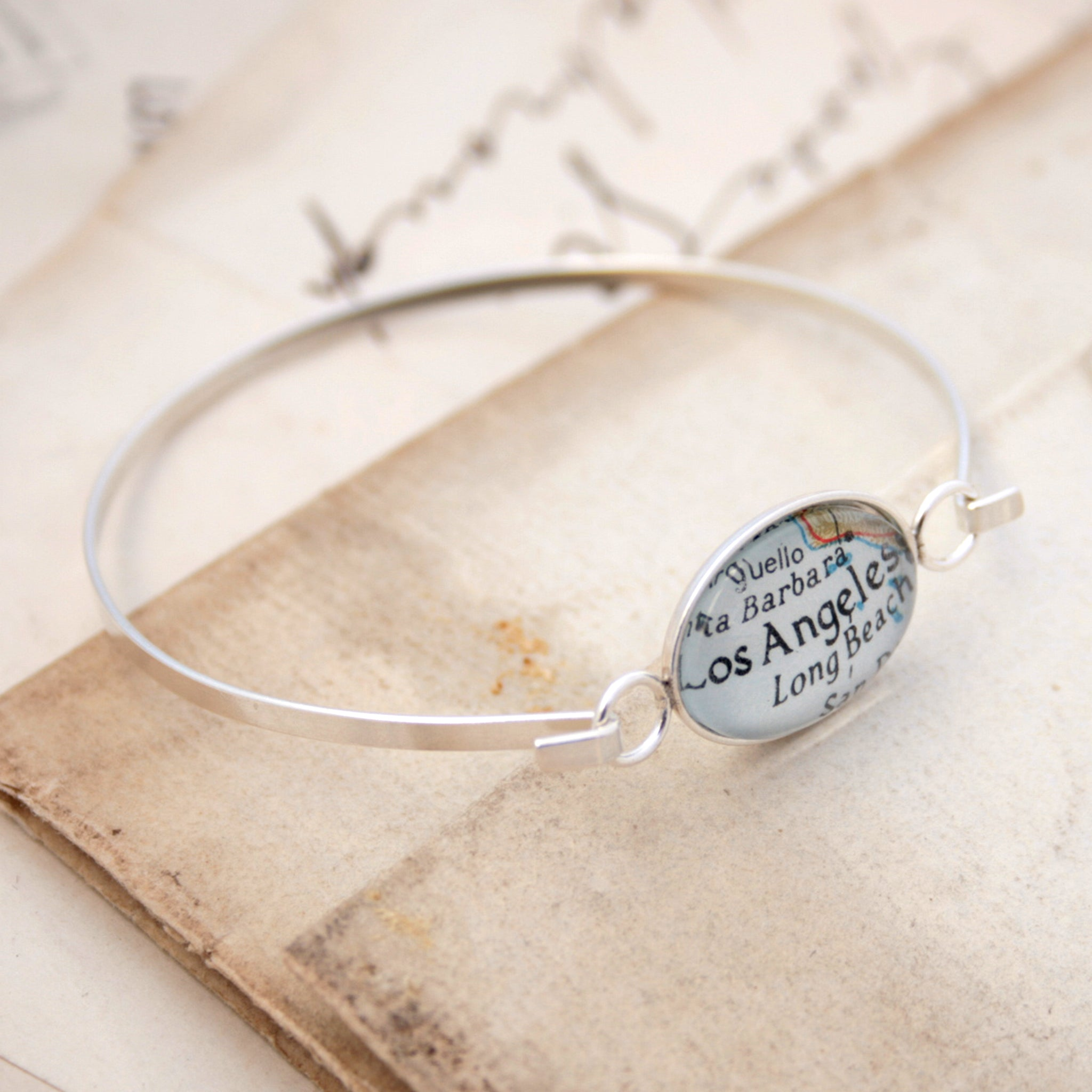Sterling silver bangle bracelet featuring map of Los Angeles