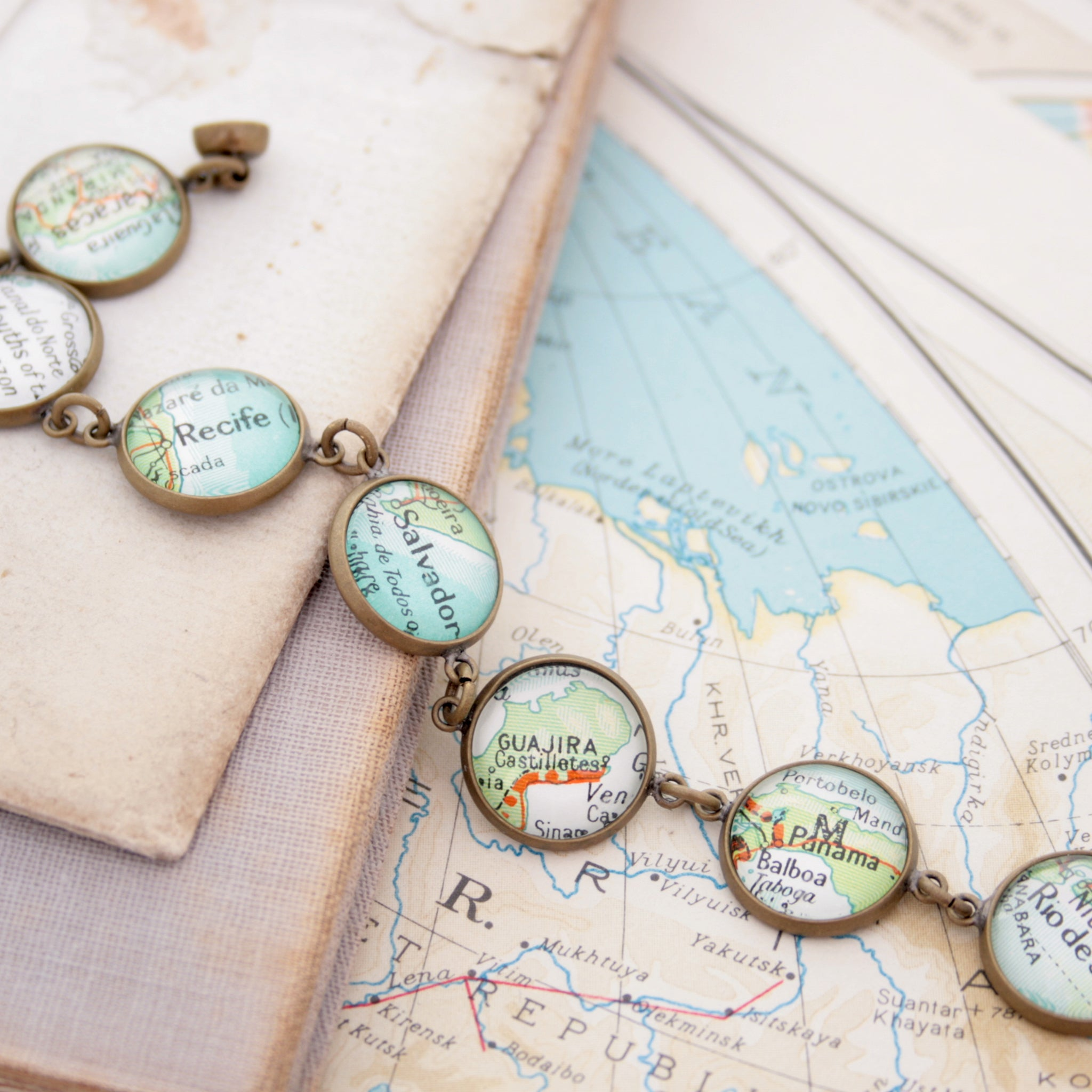 Antique bronze beaded bracelet featuring different map locations