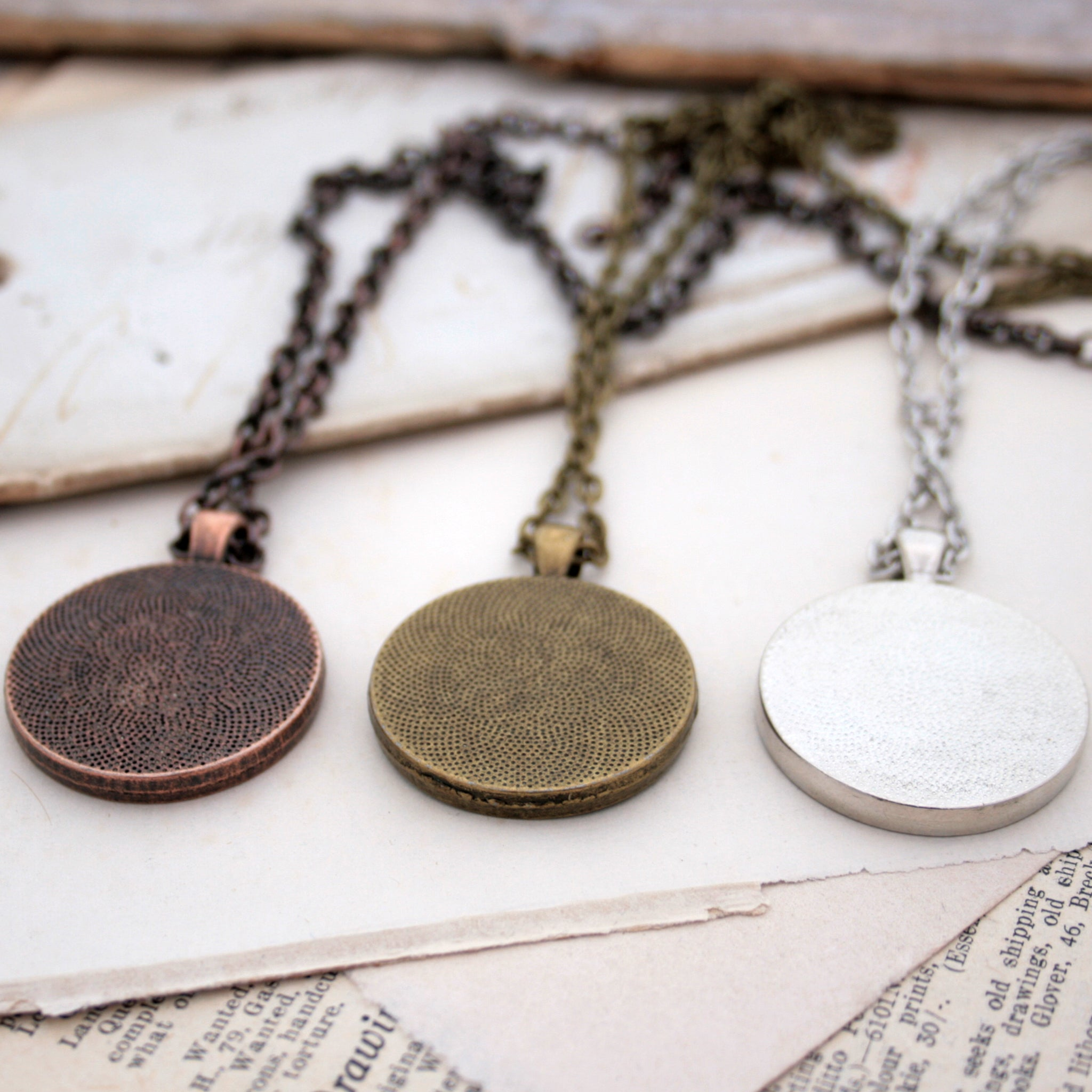 Copper, bronze and silver necklaces on the backside