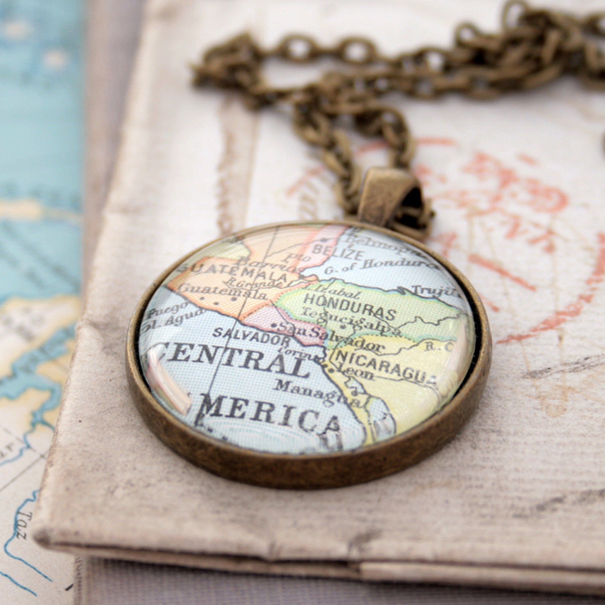 Antique bronze statement necklace featuring map of Central America