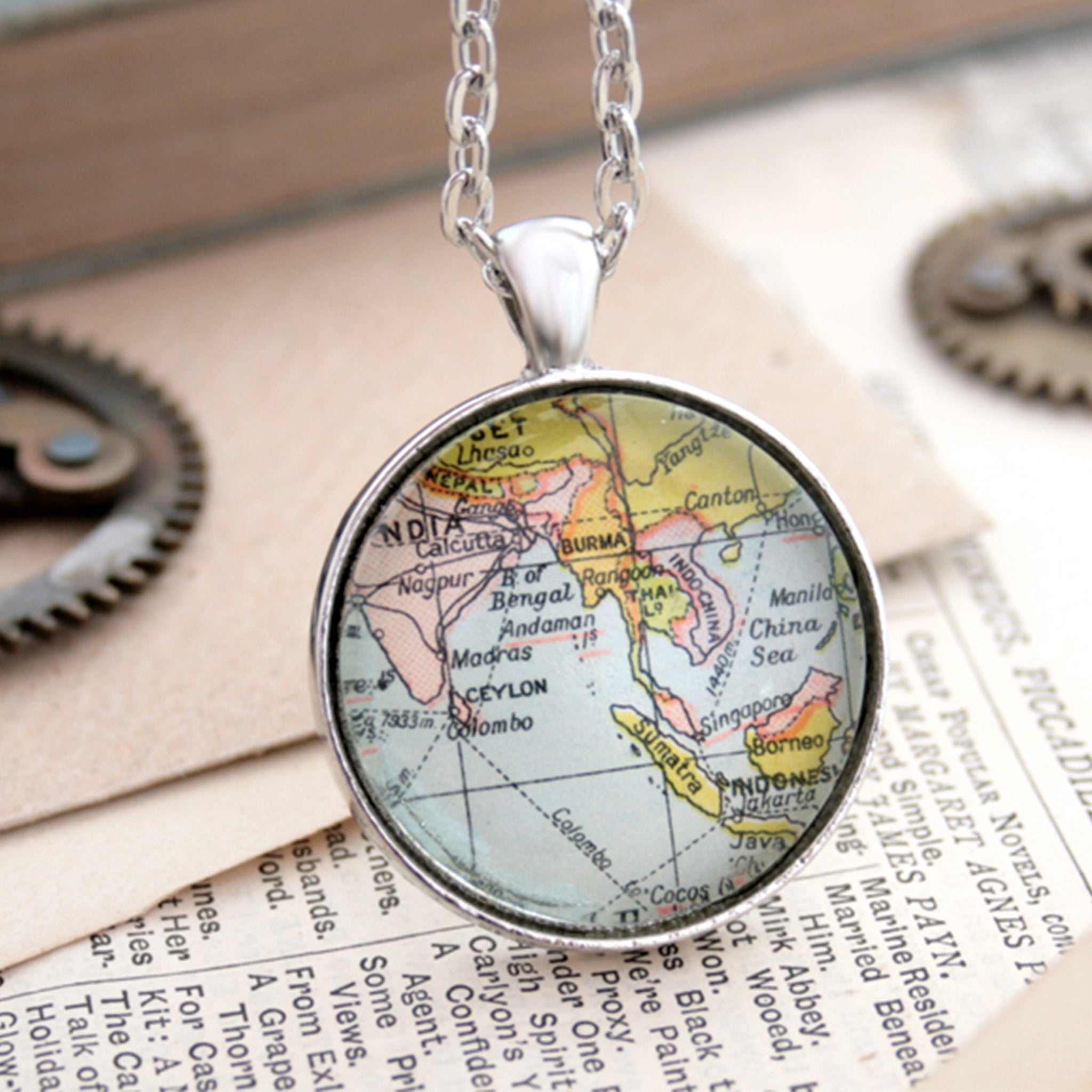 Silver tone statement necklace featuring map of South Eastern Asia