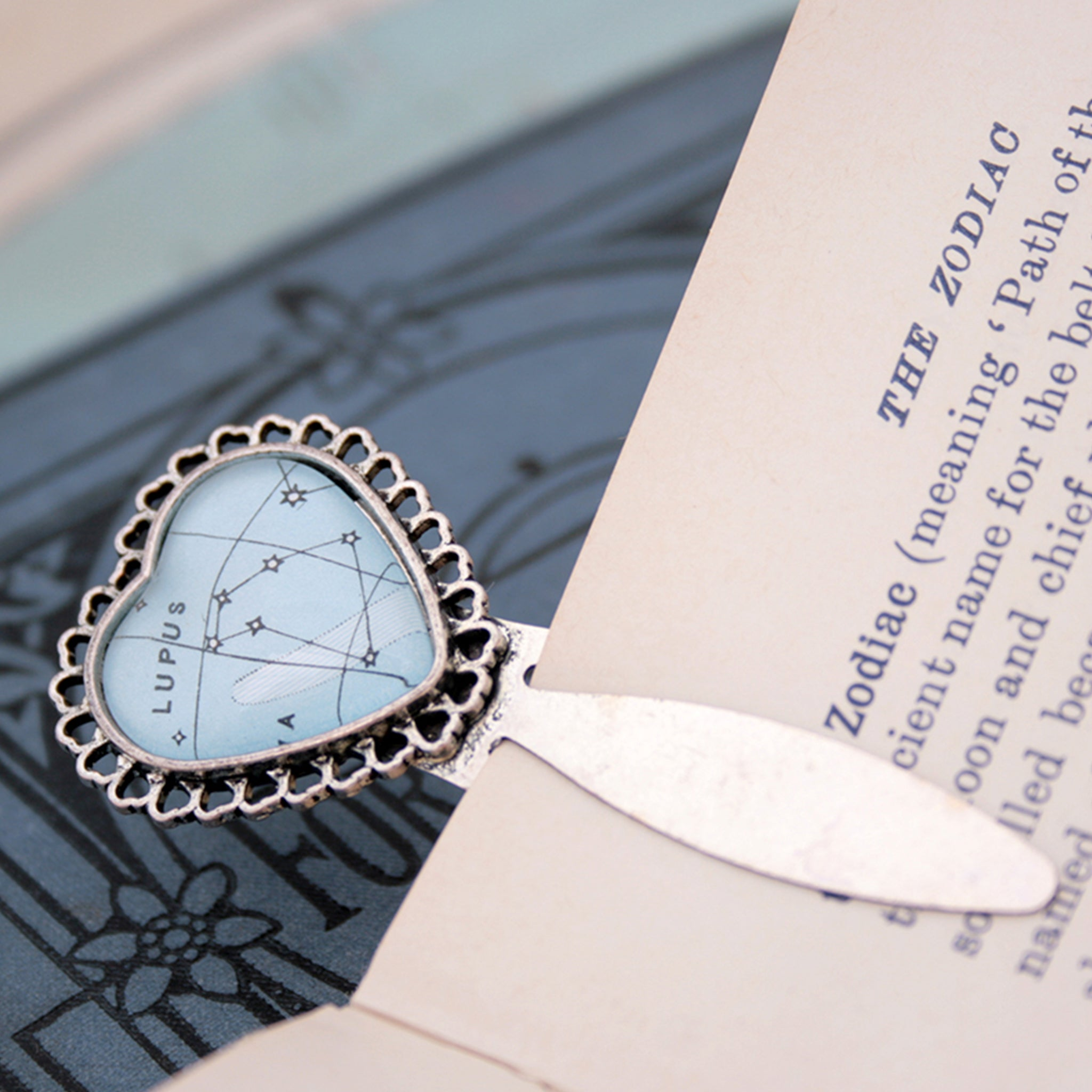 Silver heart metal bookmark featuring Lupus constellation