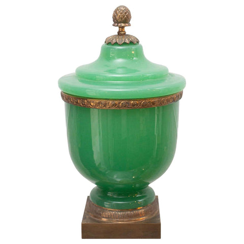 ANTIQUE GREEN OPALINE COVERED JAR WITH ACORN FINIAL