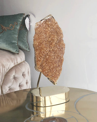 Our latest arrival in our Studio Maison Nurita line. This bold Citrine quartz stone is delicately held in place with a custom made brass setting and base. Citrine harnesses the warmth and comfort of the sun. Energize your home with this one of a kind decorative objet.