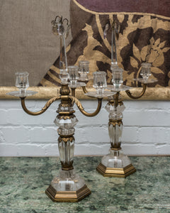 Incredibly rare and prized, these authentic Antique Rock Crystal and bronze Bagues candelabras are a statement in any interior. They are timeless and decadent. Sold as a pair.