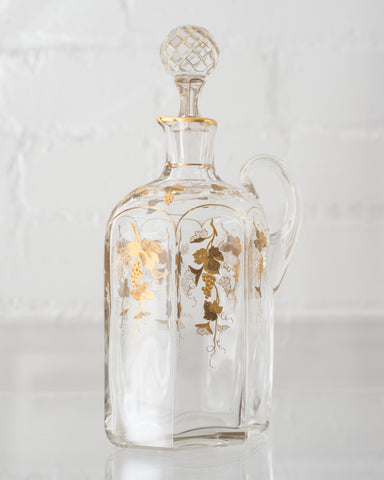 ANTIQUE GLASS AND GOLD DECANTER WITH GRAPES
