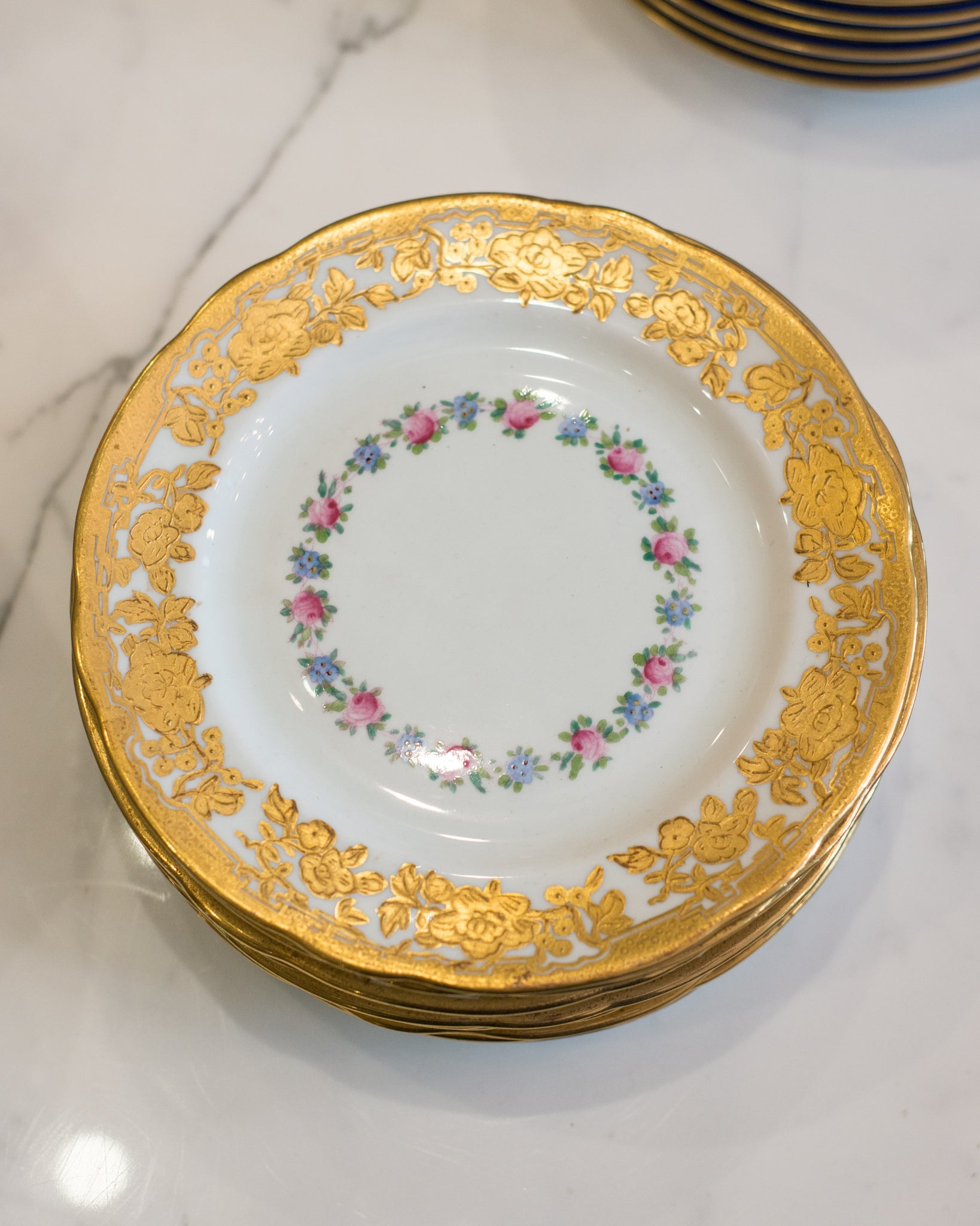 ANTIQUE SET OF 11 DESSERT PLATES EMBOSSED WITH GOLD FLOWERS