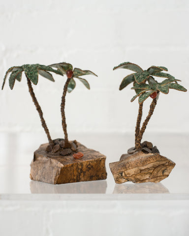 This unusual pair of semi-precious palm trees consist of Tiger's Eye trunks and Malachite leaves. These trees can be used as bookends or can remain as decorative items. Sold as a pair.