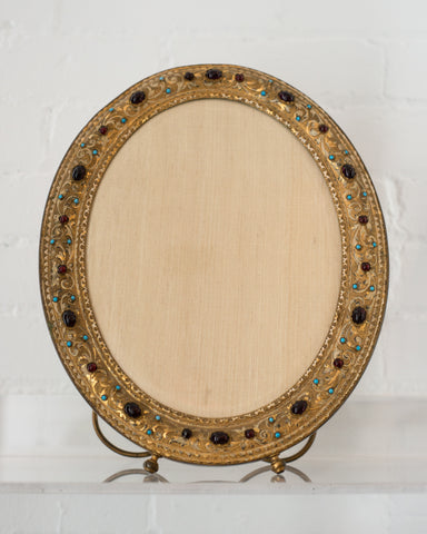An extremely decorative Antique bronze frame with semi-precious cabochons.