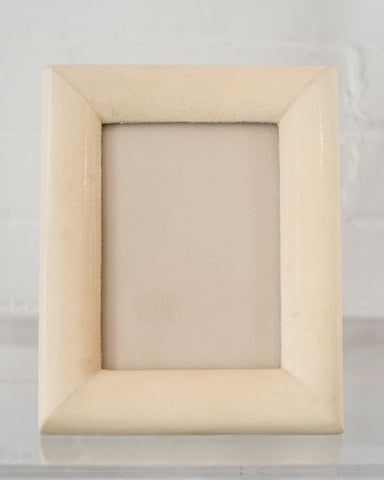 A medium picture frame in crème Shagreen & walnut,  backed in suede.