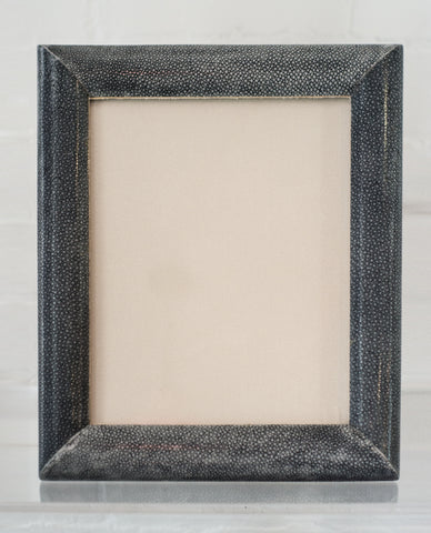 A large picture frame in blue/black Shagreen & walnut, backed in suede.