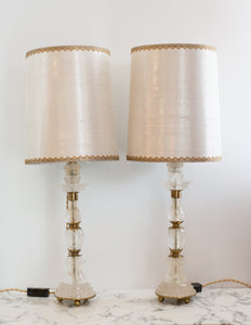 This pair of Rock Crystal and bronze lamps was sourced by Nurit in Paris. The stunning shades are hand crafted from metallic silk with vintage gold metallic trim, sourced in New York, and the interiors are silver leafed. These elegant lamps fit in a Traditional or Transitional Interior.