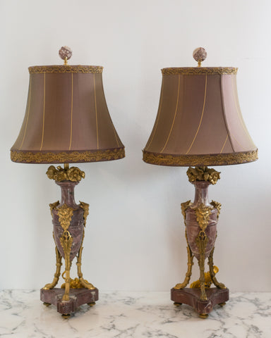 At Maison Nurita we always try to source the most unusual and rarest of antique lamps. The marble and bronze work on this pair of Antique French lamps is beautiful. These lamps have been carefully rewired and finished with a handmade custom silk taffeta shade with metallic trim. Sold as a pair.