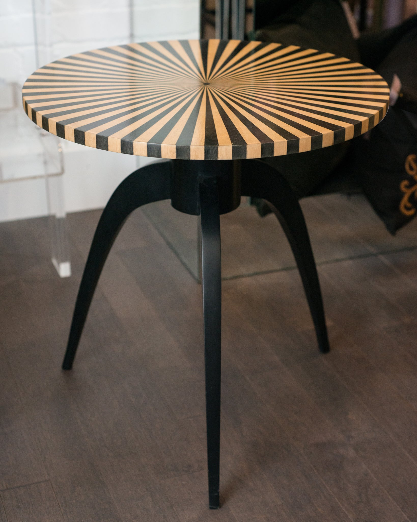 CONTEMPORARY SATINWOOD TABLE WITH BLACK LEGS