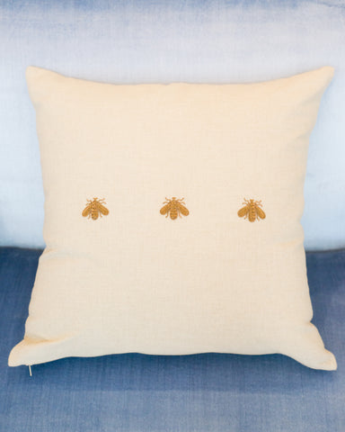 3 METALLIC BEES EMBROIDERED ON A LINEN PILLOW