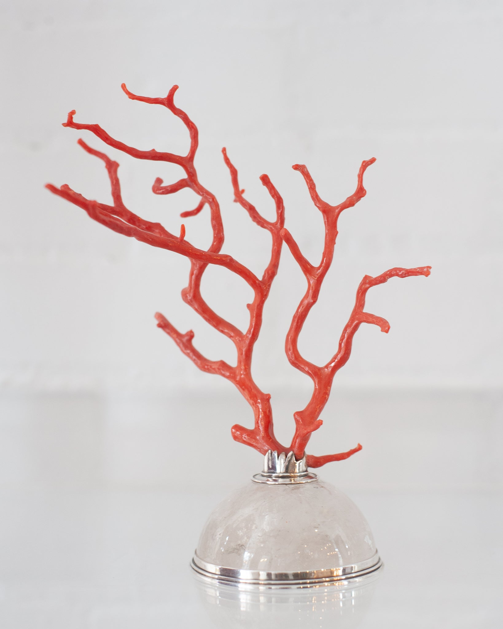 CONTEMPORARY CORAL BRANCH ON A ROCK CRYSTAL & STERLING SILVER BASE, PESTELLI
