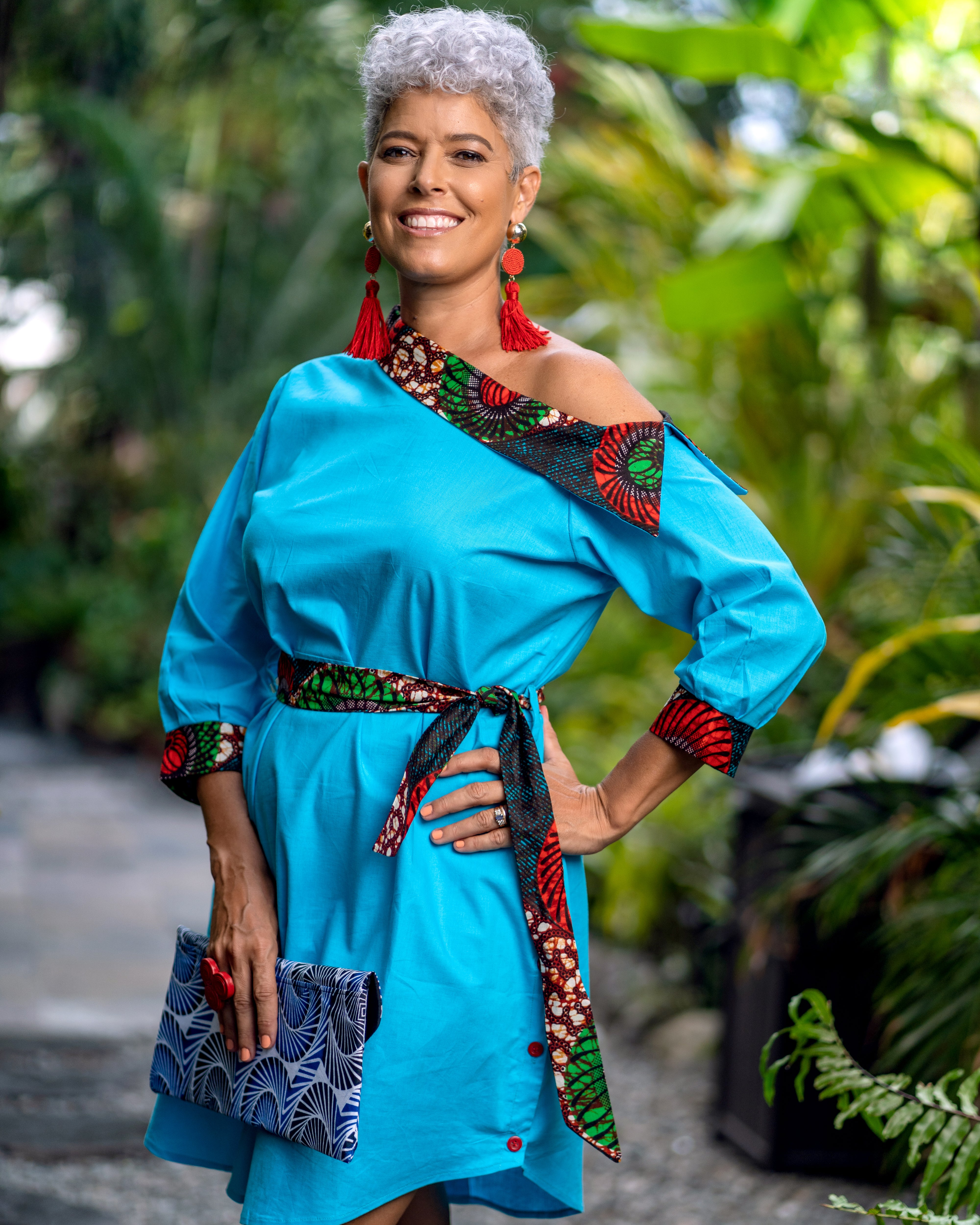 Blue high low, off the shoulder dress with tribal/african print detailing and tied waist