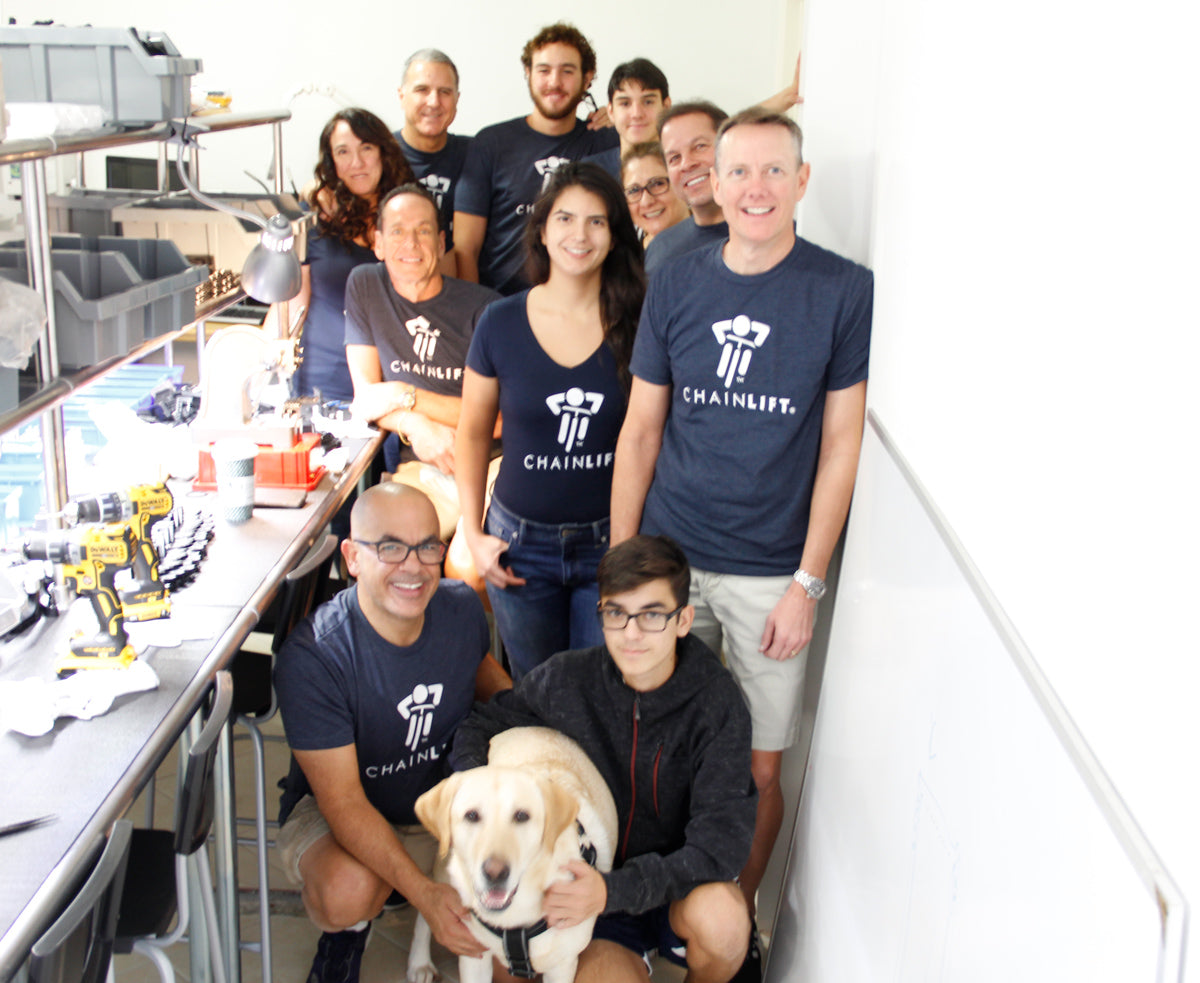 Chainlift - About Us - Team with Dog