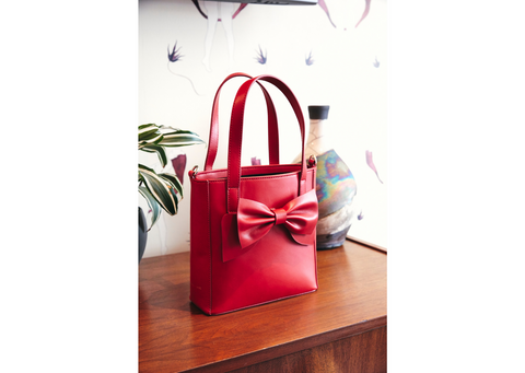 Red leather mini tote with red leather bow.