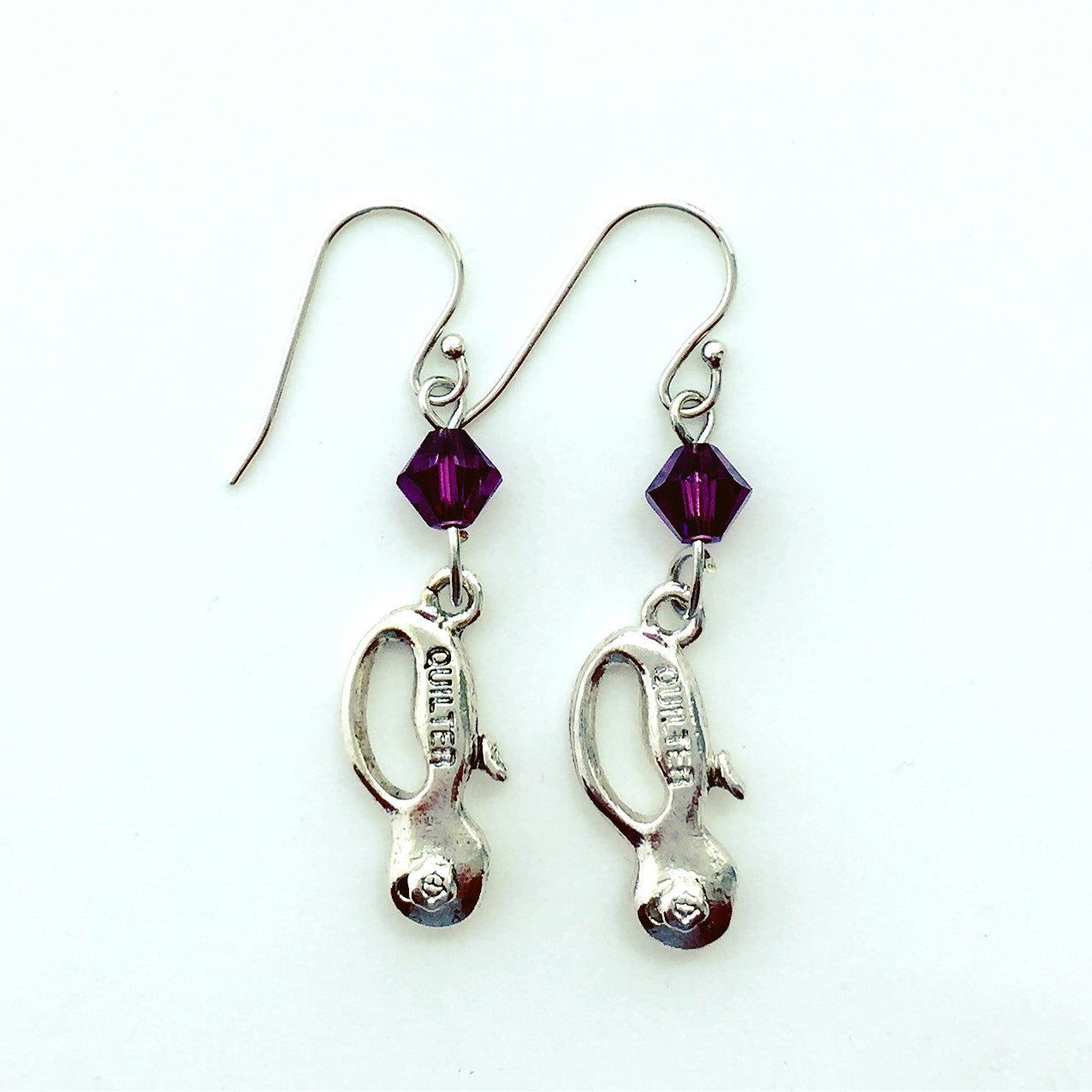 ____ Quilt Cutter Silver Earrings with Purple Swarovski Crystals.