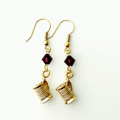 ____ Spool of Thread Gold Earrings with Purple Swarovski Crystals.
