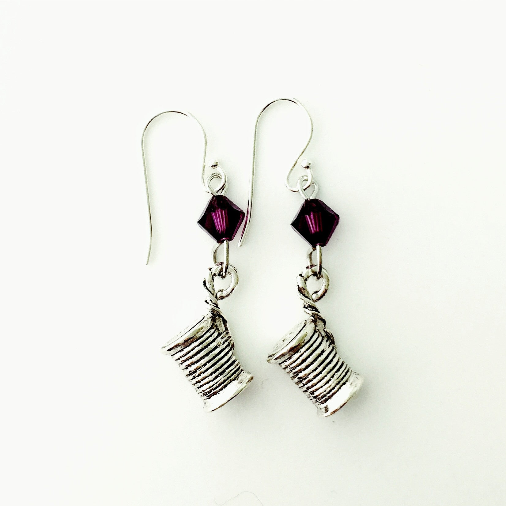 ____ Spool of Thread Silver Earrings with Purple Swarovski Crystals.