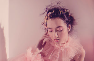 Dreamy pink bride wearing tulle dress and pastel hairvine
