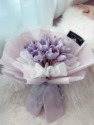 fresh purple tulips with purple wrapping paper