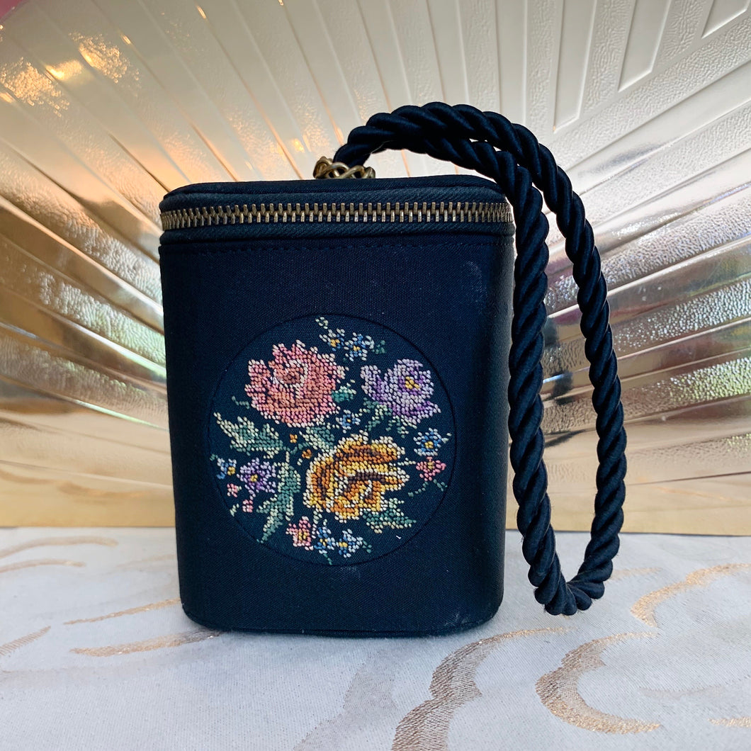 embroidered wrist bag
