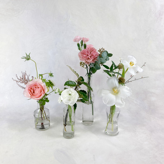 Our most versatile quartet! Four piece budvase set to dress up those high-top cocktail tables, guestbook table, cake table, bar area or alternate between the Ella Main Centerpieces or the Ella Accent Arrangement to give more dimension and interest to your reception tablescape!