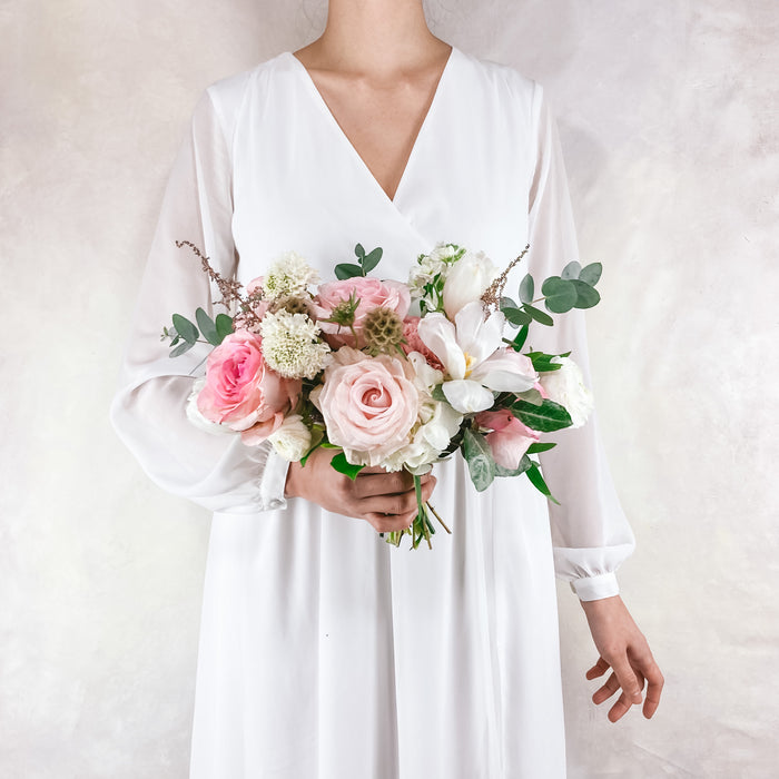 "Our perfectly gathered petite bouquet with luscious blush and cream toned blooms. This bouquet averages around 6-8"" in diameter and is perfect for a petite bridesmaid style, jr bridesmaids and even for moms and grandmothers!"